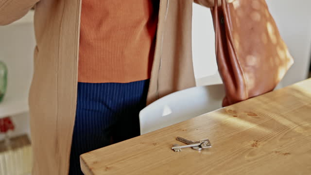 woman preparing to leave home and run errands - dining room stock videos & royalty-free footage