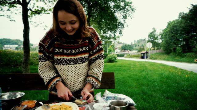 woman preparing tortilla on picnic - tortilla flatbread stock videos & royalty-free footage