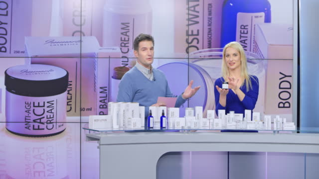 ld woman presenting cosmetic products on the infomercial hosted by a male host - television show stock videos and b-roll footage