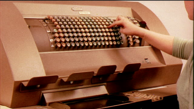 1958 MS ZO Woman pressing keys on comptometer, large calculator / USA / AUDIO
