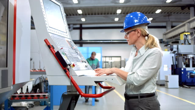 DS Woman Programming A CNC Machine