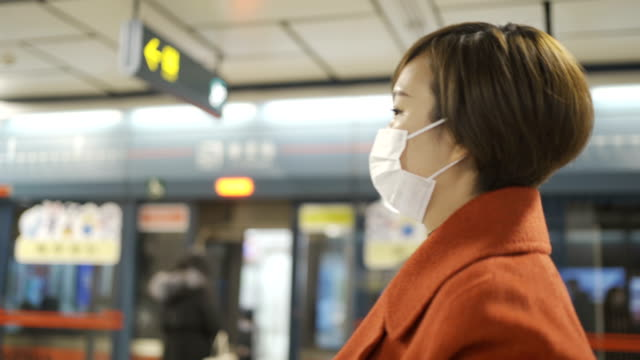 woman protect yourself from the  covid-19 with masks in metro - protection stock videos & royalty-free footage