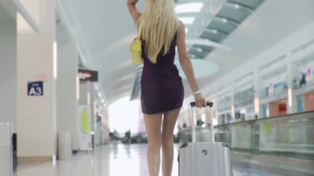 ms pov woman pulling suitcase through in airport / jacksonville, fl, united states - beautiful woman stock videos & royalty-free footage