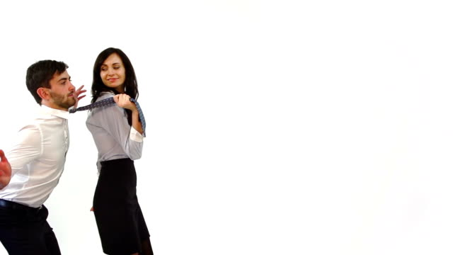 woman pulling the tie of a man - tie stock videos and b-roll footage
