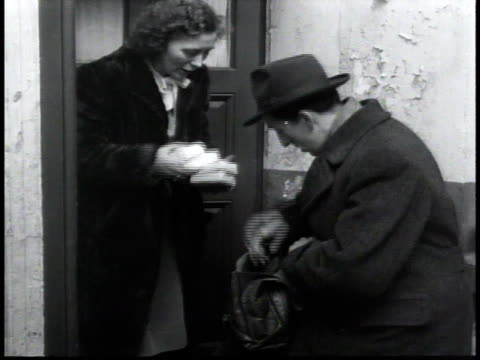 woman purchasing items from black marketeer - postwar stock videos & royalty-free footage