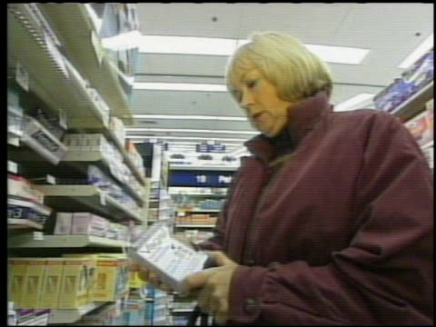/ woman purchasing vagisil moisturizer in drugstore / dr lila nachtigal of nyu medical center speaking about how women want a viagra type of pill as... - anti impotence tablet stock videos & royalty-free footage