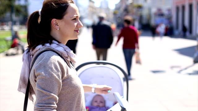 woman pushing baby stroller - three wheeled pushchair stock videos & royalty-free footage