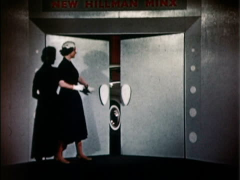 1957 ws woman pushing doors open to reveal new 1957 hillman minx in showroom lined with red curtains / usa - nur junge frauen stock-videos und b-roll-filmmaterial