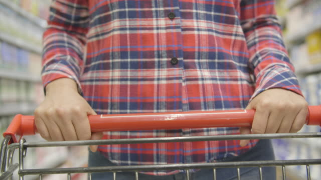 woman pushing shopping cart - decapitated stock videos & royalty-free footage