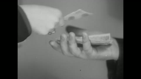 1938 woman puts money into man's hand - exchanging stock videos & royalty-free footage