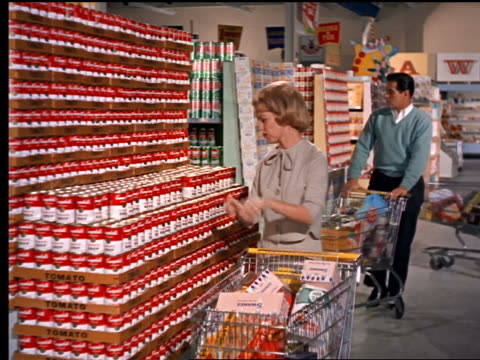 1962 PAN woman puts soup in cart / second woman puts frozen juice in cart / grocery store
