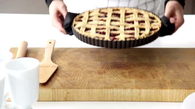 woman putting a baked pie on counter top - tart dessert stock videos & royalty-free footage