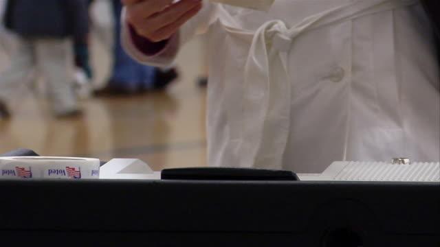 cu, woman putting ballot into machine, ypsilanti, michigan, usa - ypsilanti video stock e b–roll