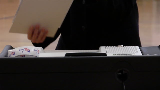 CU, Woman putting ballot into machine, Ypsilanti, Michigan, USA