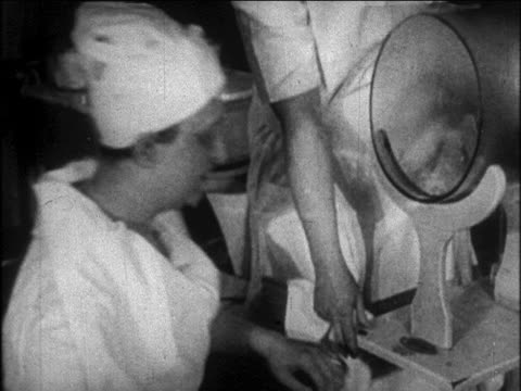 b/w 1926 woman putting face in anti-wrinkle steam machine in beauty school / newsreel - 1926 stock videos & royalty-free footage