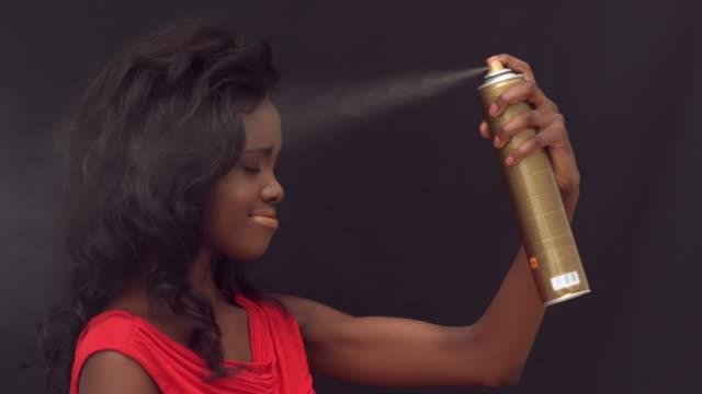 woman putting hairspray on herself - hair spray stock videos & royalty-free footage