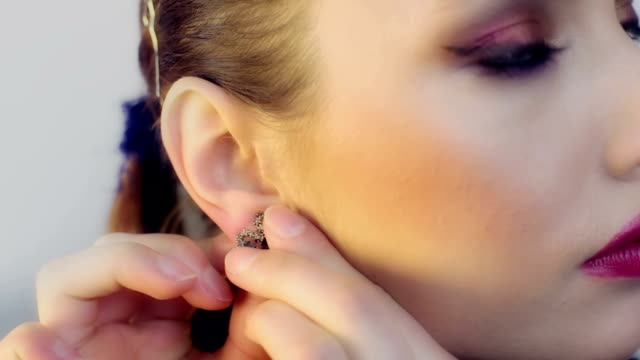 woman putting her earrings - earring stock videos & royalty-free footage