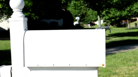 woman putting mail in mailbox and raising flag - letterbox stock videos & royalty-free footage