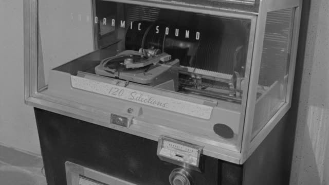 b/w woman putting money in jukebox + making selection / eleventh hour (1963) - jukebox stock videos & royalty-free footage