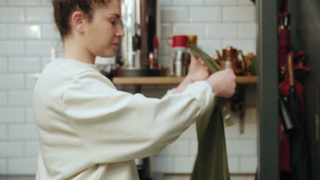 woman putting on apron - apron stock videos & royalty-free footage