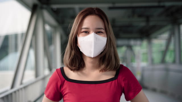 woman putting on homemade protective mask - endurance stock videos & royalty-free footage