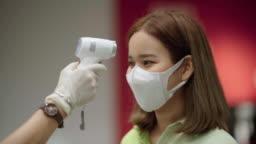 Woman putting on homemade protective mask