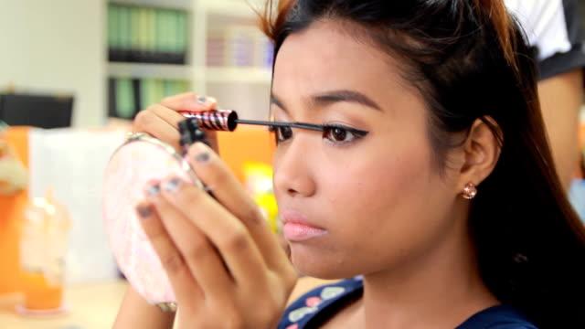 woman putting on mascara - mascara stock videos & royalty-free footage