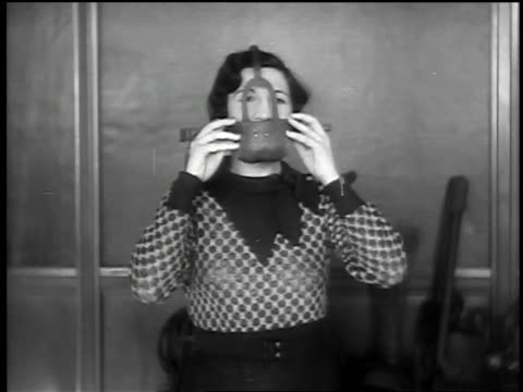 b/w 1932 ms woman putting on metal mask which covers mouth - domination stock videos & royalty-free footage