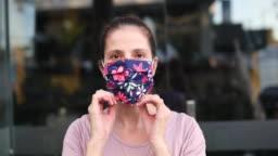 Woman putting protective mask on