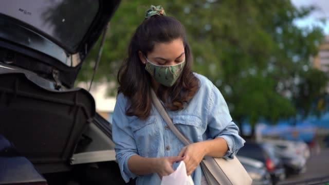 woman putting purchases in the trunk during the coronavirus pandemic - mesquita stock videos & royalty-free footage