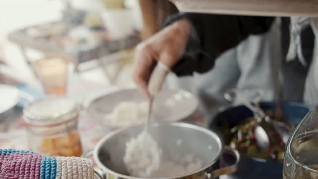 woman putting steaming rice on plates - table stock videos & royalty-free footage