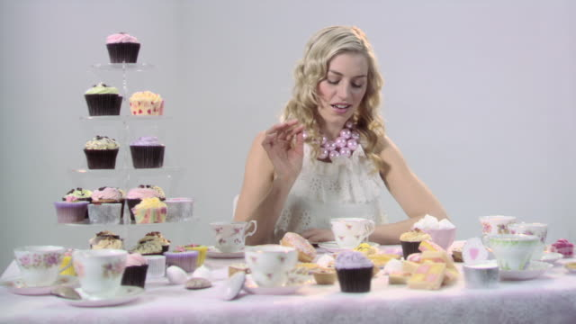 woman putting sugar in tea - tea party stock videos and b-roll footage