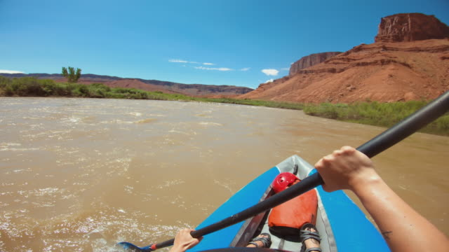pov woman rafting with kayak in colorado river, moab: extreme adventures in usa - rafting stock videos & royalty-free footage