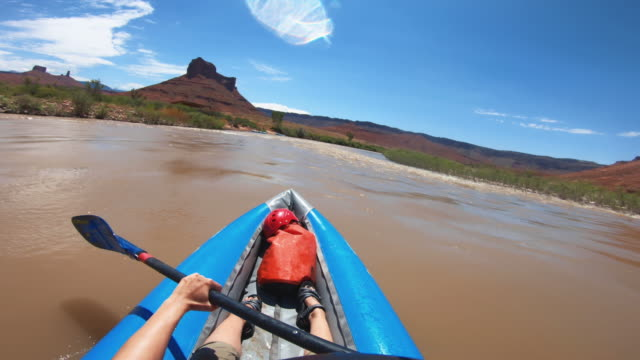 pov  woman rafting with kayak in colorado river, moab - dinghy stock videos & royalty-free footage