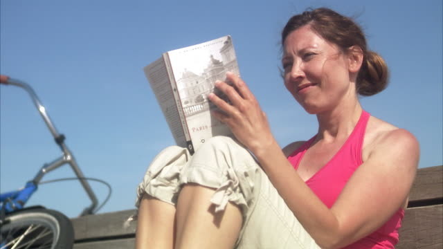 a woman reading a book skane sweden. - only mature women stock videos & royalty-free footage