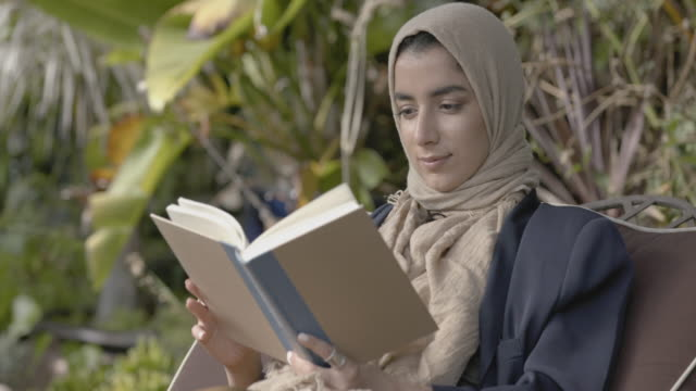woman reading a book - middle eastern ethnicity stock videos & royalty-free footage