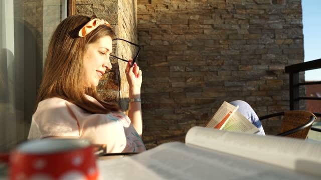 woman reading a magazine - magazine publication stock videos & royalty-free footage