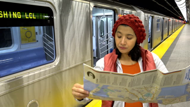 woman reading a subway map, new york city - number 7 stock videos & royalty-free footage