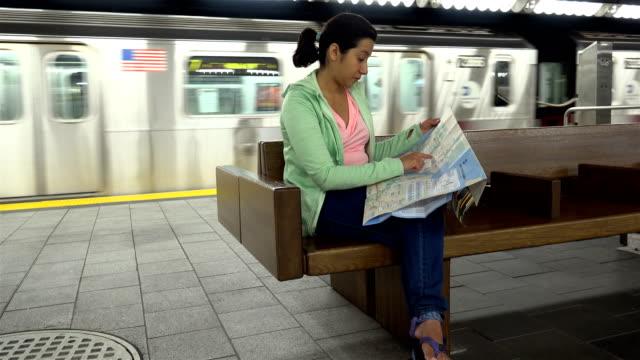 Woman reading a Subway Map, New York City