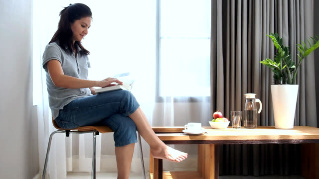 woman reading book at home - home showcase interior stock videos & royalty-free footage