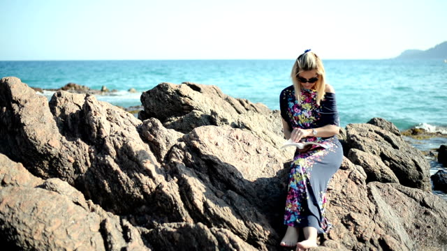 woman reading book at the beach - cannes stock videos & royalty-free footage
