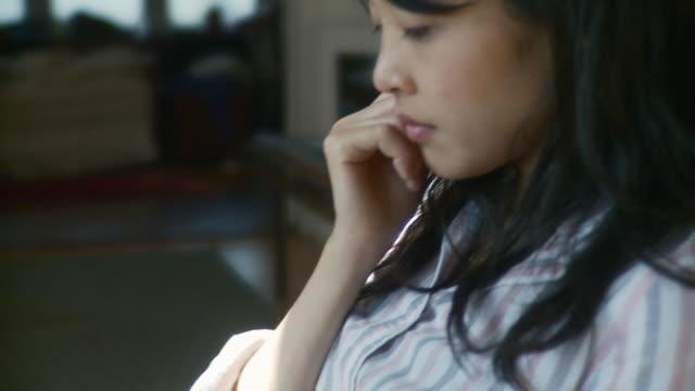 CU TU TD Woman reading electronic book on digital tablet / Brooklyn, New York, USA