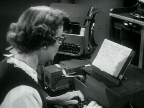 b/w 1956 woman reading from paper + typing on telegraph / western union - telegram stock videos and b-roll footage