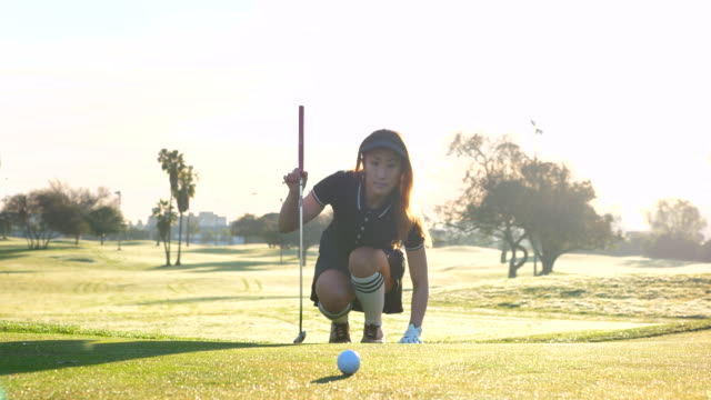 ms woman reading green during early morning round of golf - golf stock videos & royalty-free footage