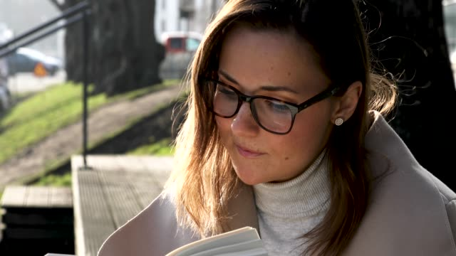 Woman reading in the city