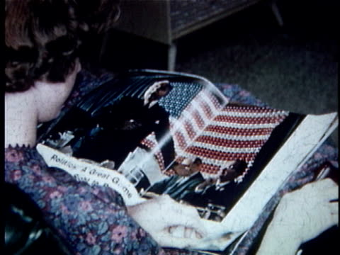 ha cu woman reading life magazine and turning pages / usa - 1961 stock-videos und b-roll-filmmaterial