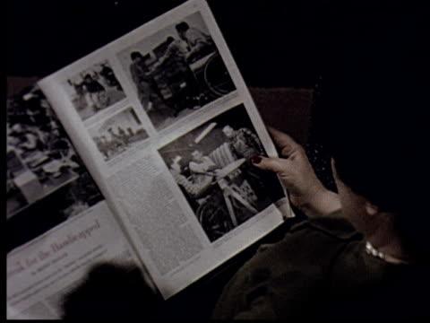 cu, ha, woman reading magazine sitting in armchair - magazine stock videos & royalty-free footage