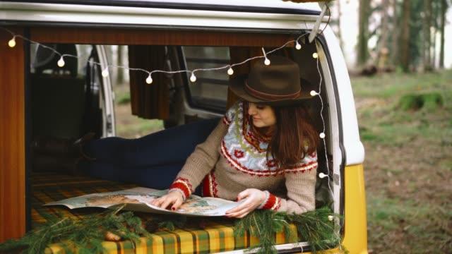 woman reading map in vintage  camper van - road map stock videos & royalty-free footage