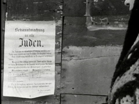 cu, zi, b/w, woman reading nazi poster on wall, usa - judaism stock videos & royalty-free footage