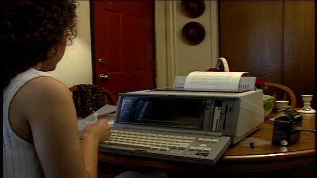 vídeos de stock e filmes b-roll de woman reading paper printed from electronic word processor - trabalhadora de colarinho branco
